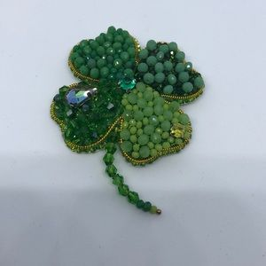 Hand made beaded brooch.  Cloverleaf